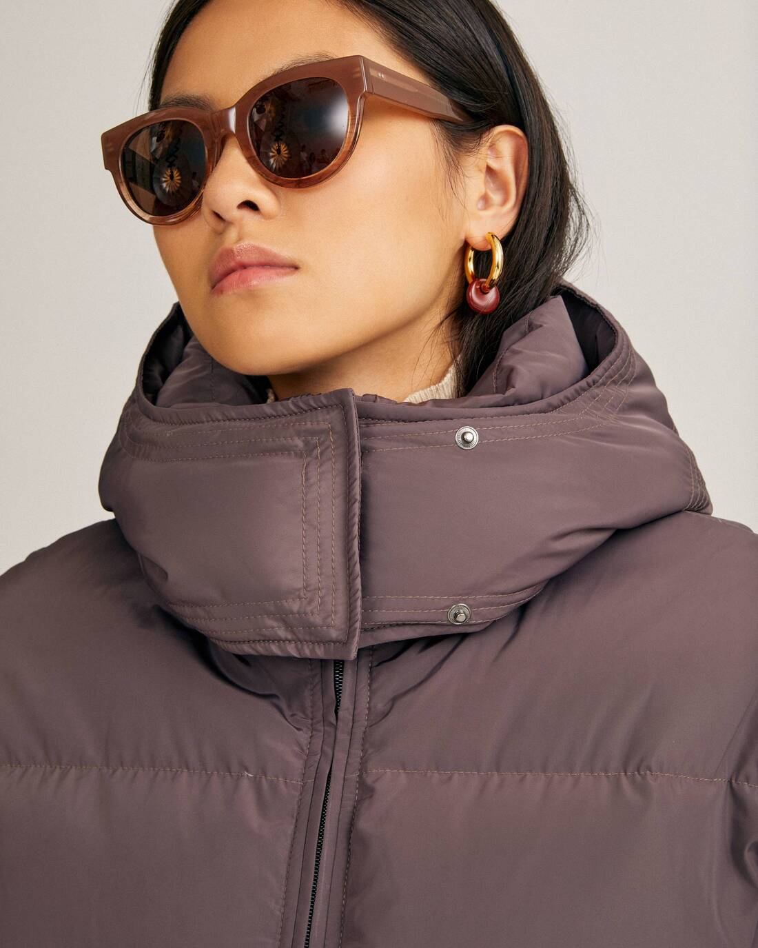 Elongated down jacket with hood