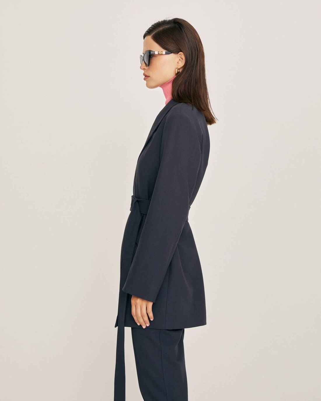 Elongated jacket with a belt