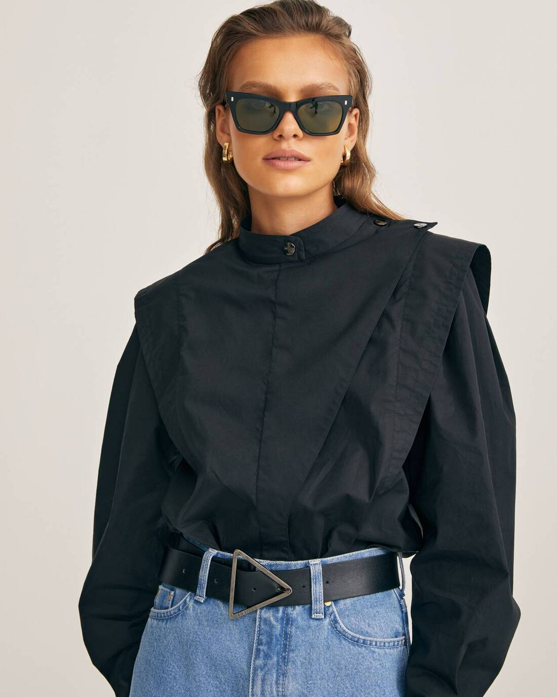 Blouse with voluminous sleeves and a band collar