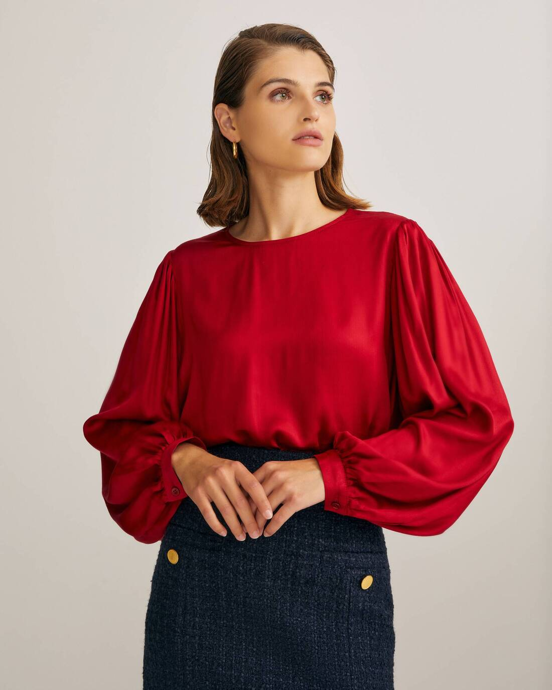 Flowy ruffled blouse with puff sleeves